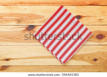 Empty wooden deck table with tablecloth on wooden table for dinner for product montage. Free space for your text. Top view horizontally.