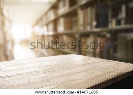 Empty wooden desk space platform with library background for product display. - stock photo