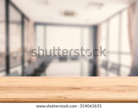 empty wooden desk with office background - stock photo