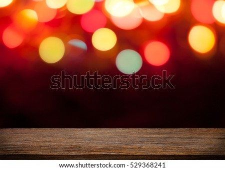 Empty wooden floor. blurred bokeh light background. There is an empty space for productions