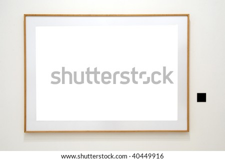 Empty wooden frame isolated on white in wall museum with label - stock photo