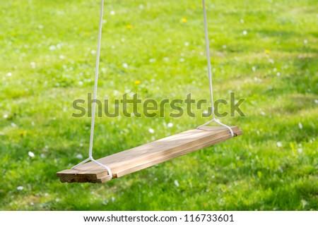 Empty Wooden Garden Swing - stock photo