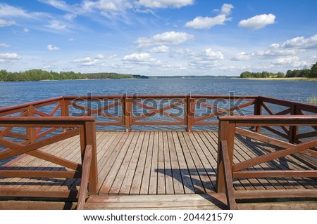 Empty wooden jetty on the lake shore, Mazury, Poland