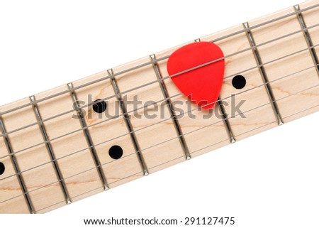 Empty wooden maple fingerboard with red pick between strings of classic shaped electric guitar closeup isolated on white background with clipping path. Free frets and strings as improvisation concept - stock photo