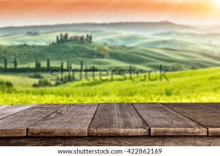 Empty wooden planks with Italian landscape on background. Ideal for product placement - stock photo