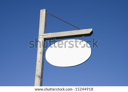 Empty wooden post and sign - stock photo