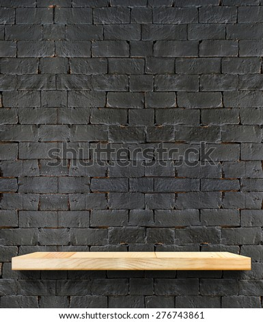 Empty Wooden shelf at black brick wall,Template mock up for display of product,business presentation. - stock photo