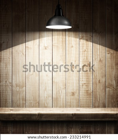 Empty wooden shelf under the lamp - stock photo
