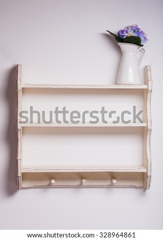 Empty wooden shelf with three hooks on the isolated background - stock photo