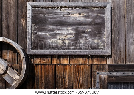 empty wooden sign on a weathered wall  - stock photo
