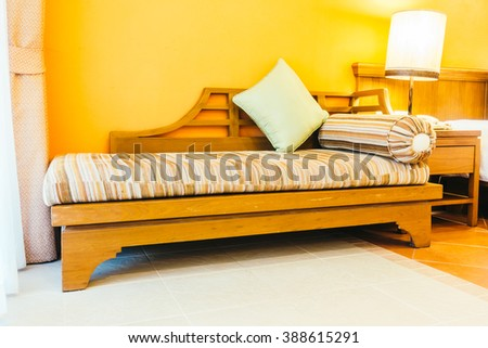 Empty wooden sofa with pillow and chair decoration in living room interior - Vintage Filter