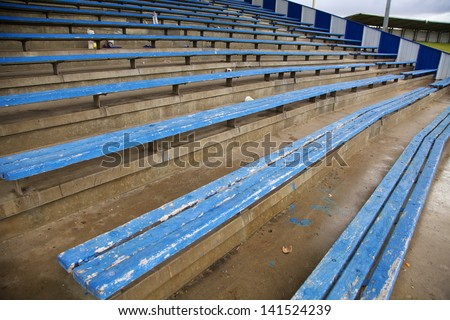 Empty Wooden Stadium Seats - stock photo