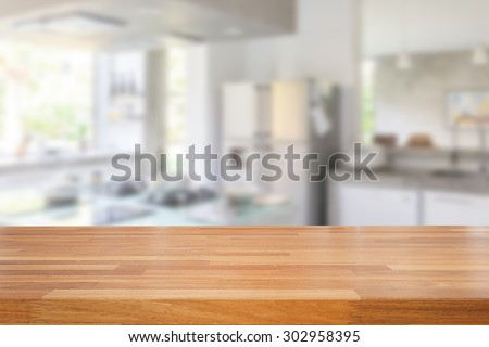 Empty wooden table and blurred kitchen background, product  montage display  - stock photo