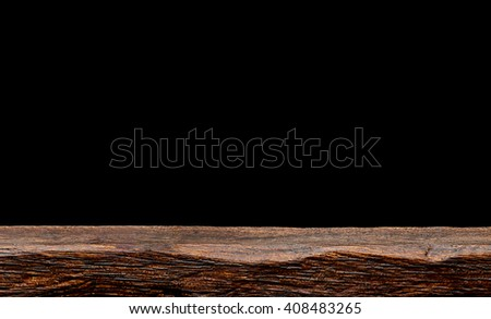Empty wooden table on black background - stock photo