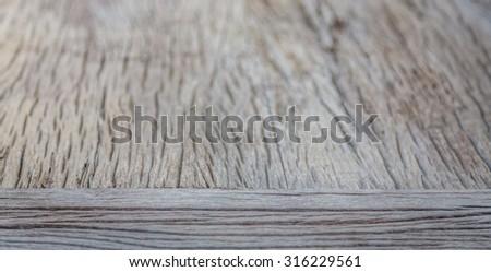 Empty wooden table on garden - stock photo