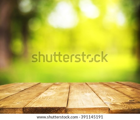 Empty wooden table on green background - stock photo
