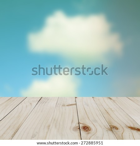 Empty wooden table on natural background. - stock photo