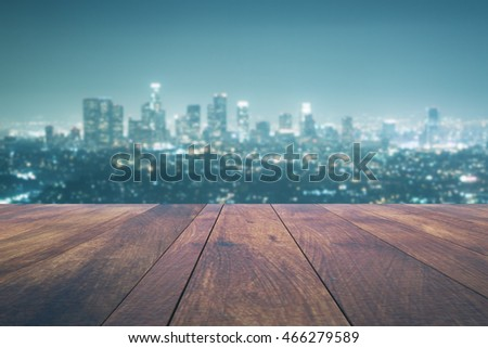 Empty wooden table on night city background. Mock up, 3D Rendering