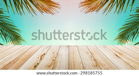 Empty wooden table on the beach - stock photo