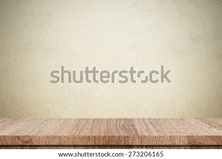 Empty wooden table over brown grunge cement wall, Product display, template