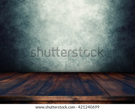 Empty wooden table over grunge wall for product montage. Dark interior template. Wooden table for product presentation. - stock photo