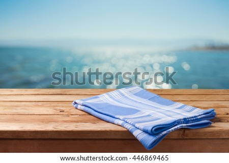 Empty wooden table over sea beach bokeh background. Summer picnic on beach background