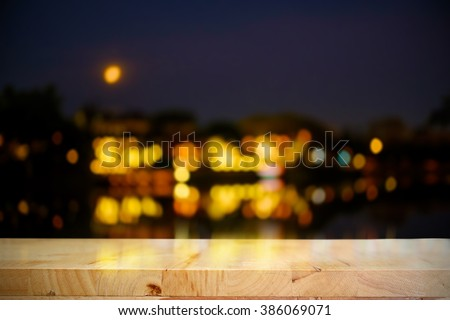 Empty wooden table platform and bokeh at night light.for products display. - stock photo