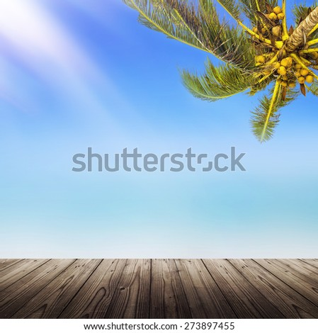 Empty wooden table. Tropical white sand beach background. Sunshine, coconut palm tree and blurry ocean.  - stock photo