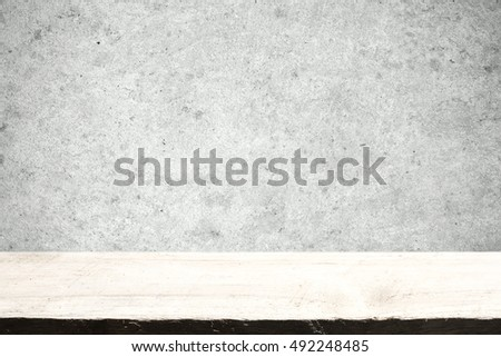Empty wooden table with grunge old concrete wall for montage or display your product