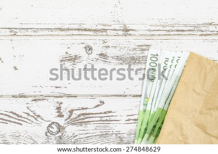 Empty wooden table with money - stock photo