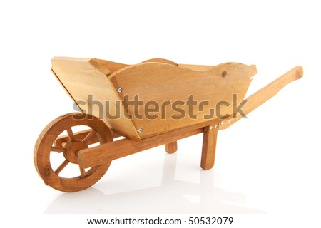 Empty wooden wheelbarrow isolated over white background