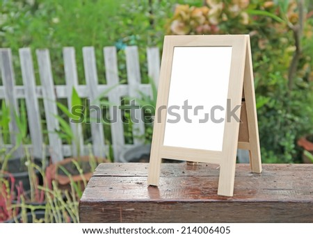 empty Wooden Whiteboard (menu board) at a coffee Shop .frame - stock photo