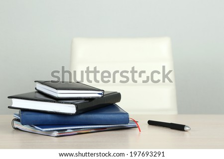 Empty workplace in office on gray background - stock photo