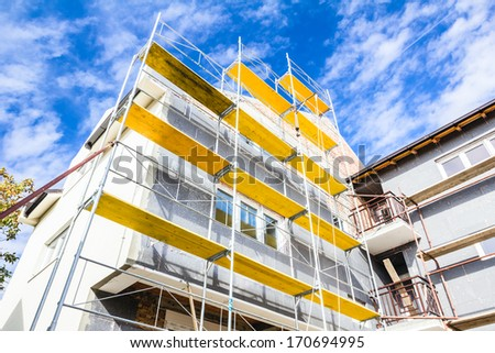 Empty workplace on scaffolding at big house. - stock photo