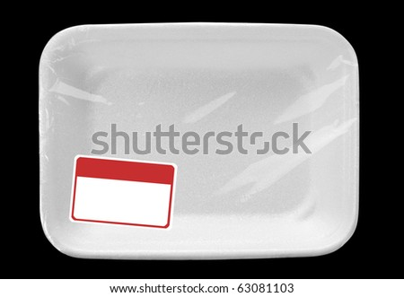 Empty wrapped white food tray with blank label. Isolated on black - stock photo