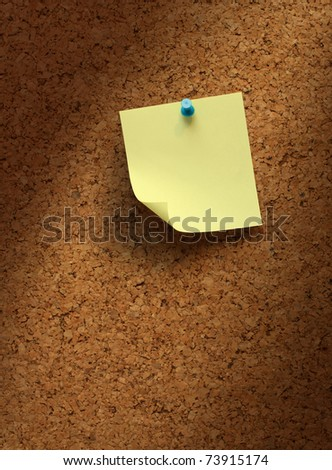 Empty yellow note paper on cork board shadow background - stock photo