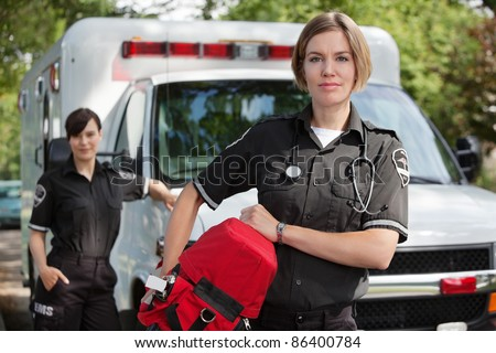 EMS professional with portable oxygen equipment - stock photo