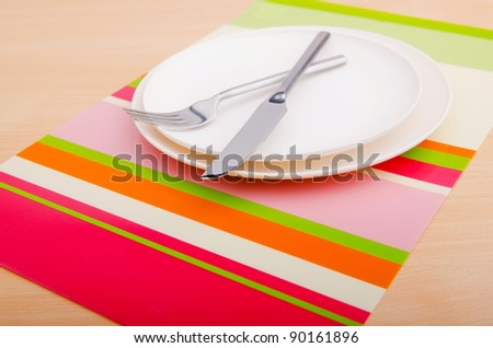 Emtpy plates with utensils on table - stock photo