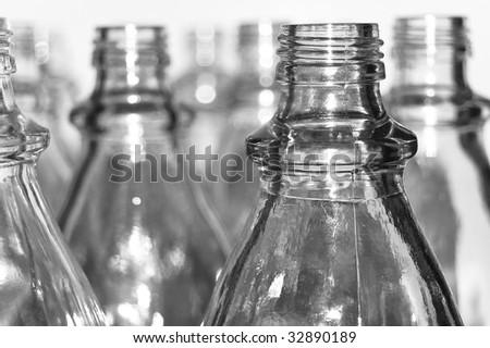 Emtpy transparent glass bottles isolated on white background. - stock photo