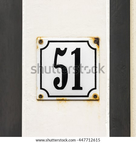 enameled house number fifty one. - stock photo