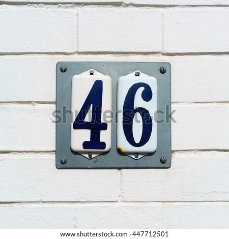 Enameled house number forty six - stock photo
