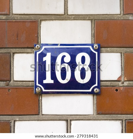 enameled house number one hundred and sixty eight - stock photo