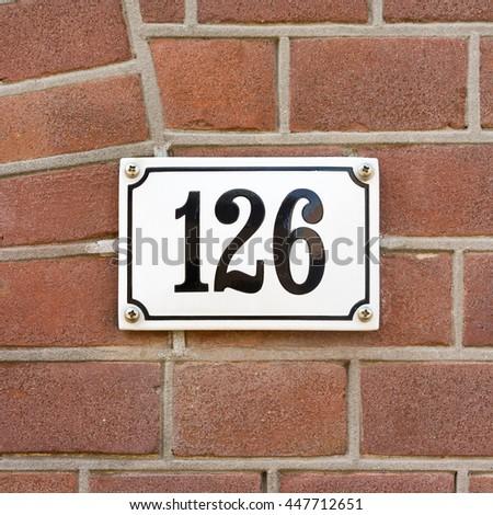 enameled house number one hundred and twenty six. - stock photo