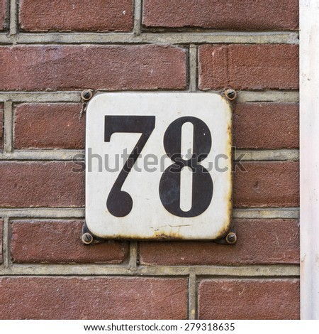 enameled house number seventy eight' - stock photo