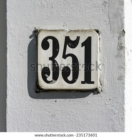 enameled house number three hundred and fifty one - stock photo