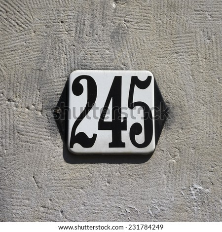 enameled house number two hundred and forty five. - stock photo