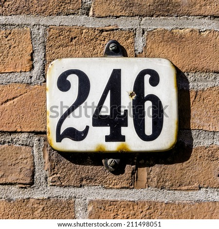 enameled house number two hundred and forty six. - stock photo