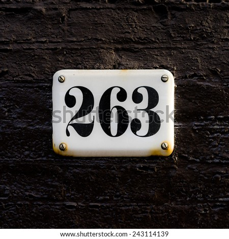 Enameled house number two hundred and sixty three. - stock photo
