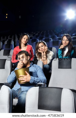 Enamoured girls admire the attractive man at cinema - stock photo