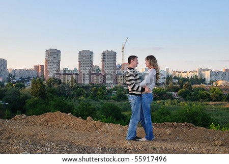 Enamoured pair on the brink of city - stock photo